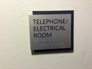 An example of an ADA Compliant office wayfinding sign.