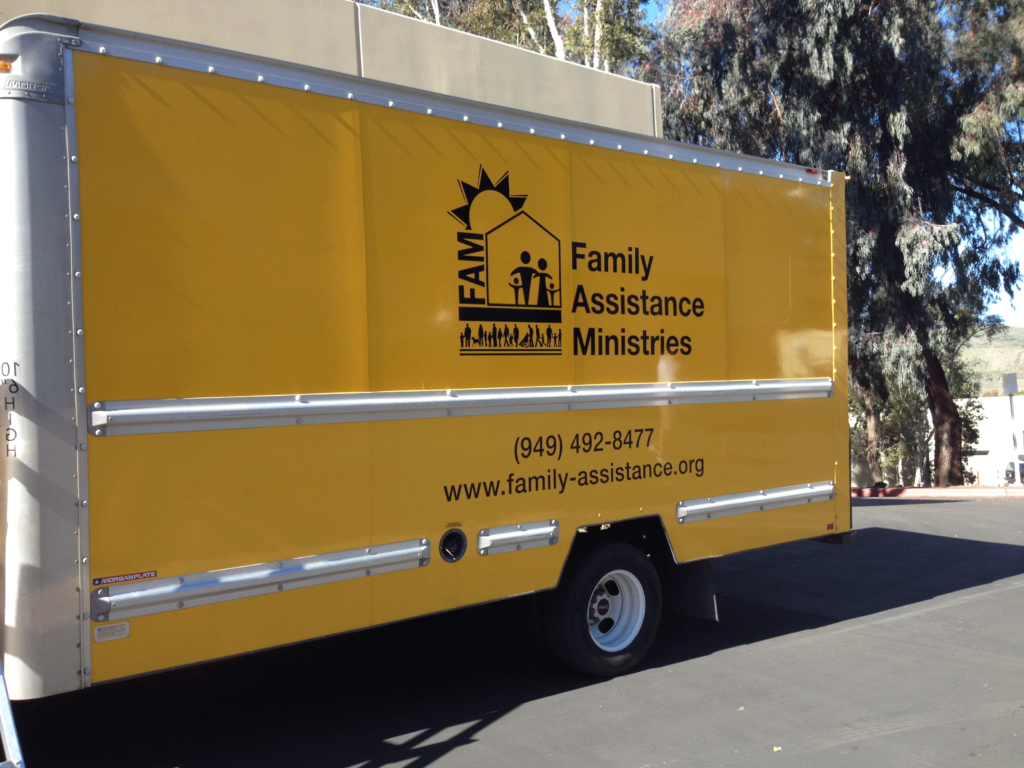 FAM side truck vehicle graphics FAM logo serves the community