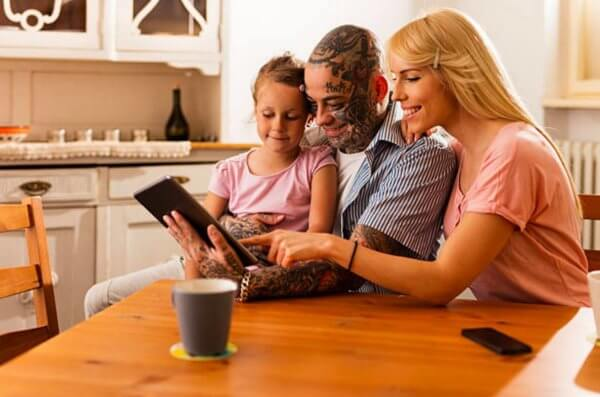 Family together looking into tablet