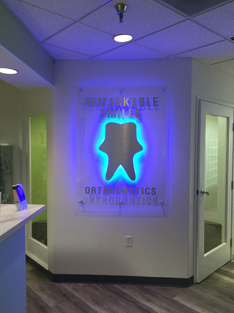 remarkable smiles orthodontics illumniated lobby signs from starfish signs & graphics